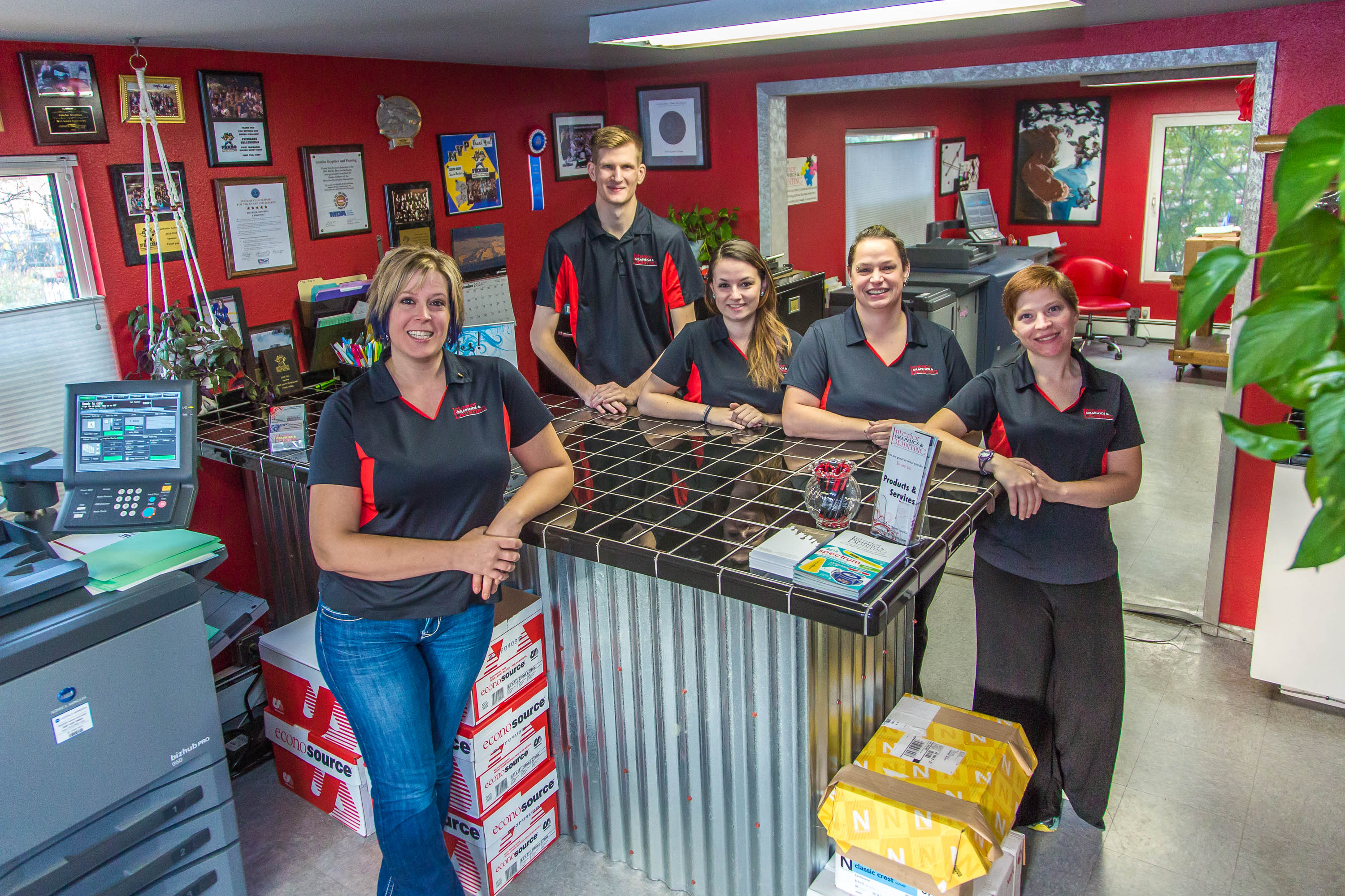 The team at Interior Graphics & Printing, including Michelle Maynard (left) and Suzie Avant (third from left).