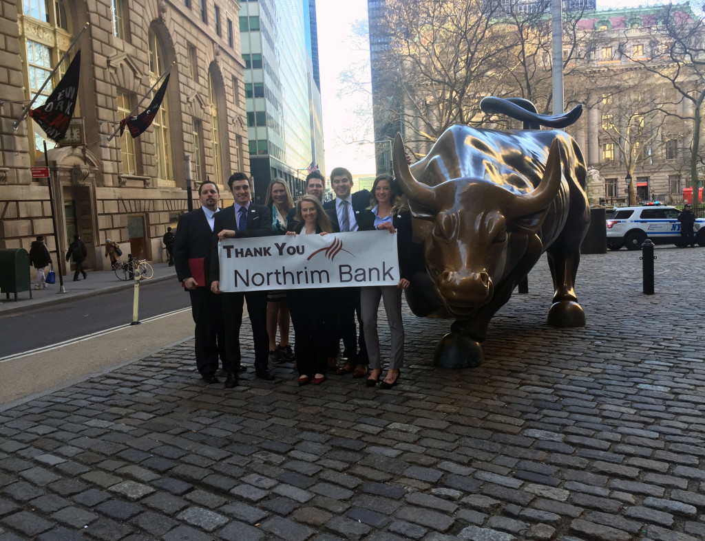 Photo by Phil Younker Tracy Reeves, Alec Hajdukovich, Kim McGinnis, Jamie Boyle, Hayden Nilson, Stefan Hajdukovich and Lacey Cruikshank pose with the Wall Street Bull.